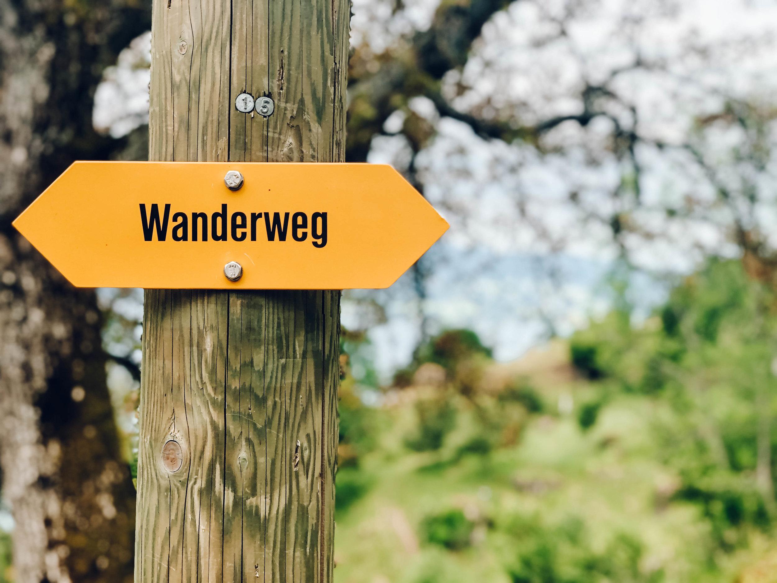 Wanderweg hiking trail sign in Switzerland.jpg