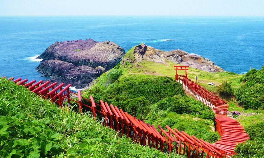 A trail of torii gates reach towards the sea at Motonosumi Inari Shrine in Yamaguchi, home to the Asahi Brewer