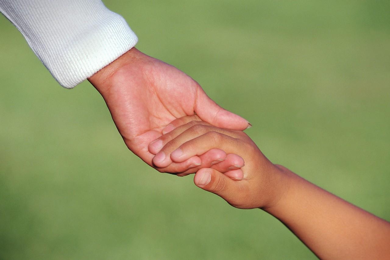 adoption-parent-child-holding-hands.jpg