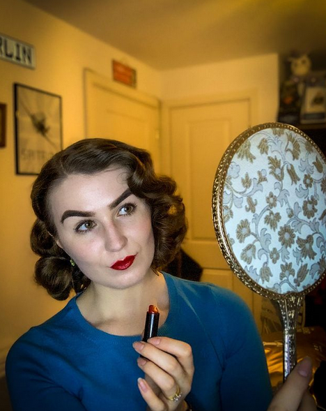 Ellen wearing red lipstick, one of her must haves for a vintage inspired look.