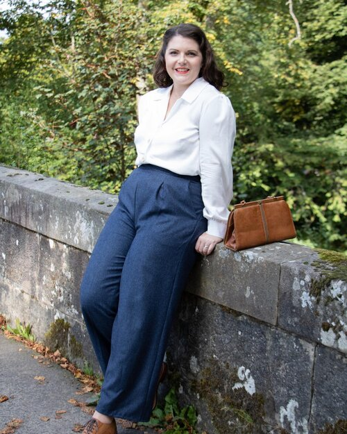 🍂🧵👜 'Patricia' trousers 👜🧵🍂  Had to share one of my favourite shots from our photoshoot yesterday with @mguthriephotography - our new navy superfine wool 'Patricia trouser - this fabric is beautiful 😍 so so soft!   There is a limited amount of this gorgeous fabric - slightly more than our usual limited edition fabrics but still limited.   We are also offering a 'Polly' waistcoat in this fabric which I think would look incredible! Paired with our 'Lillias' blouse- for the perfect autumn outfit 🍂  #vintageinspired #1940sfashion #1940sstyle #1940shair #classicstyle #madeinlangholm #limitededition #madetomeasure #madetoorder #roseswardrobevintage