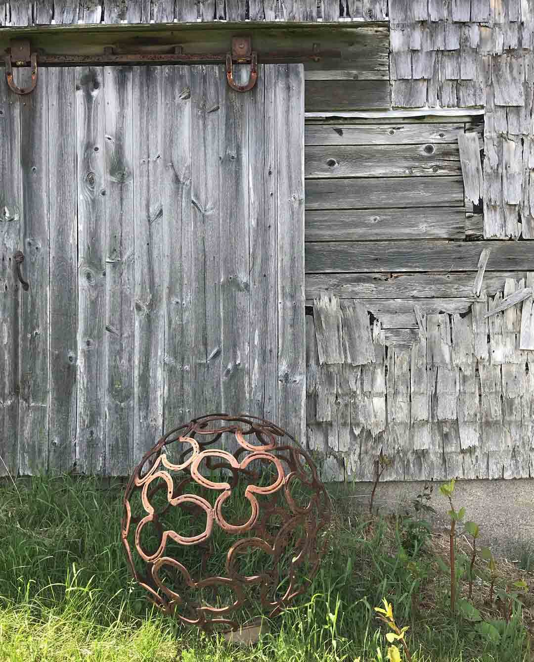 """""""You're Looking Over a 4-Leaf Clover"""", 32″ Horseshoe Sphere, Steel Number XIX by Jay Sawyer $1,600"""