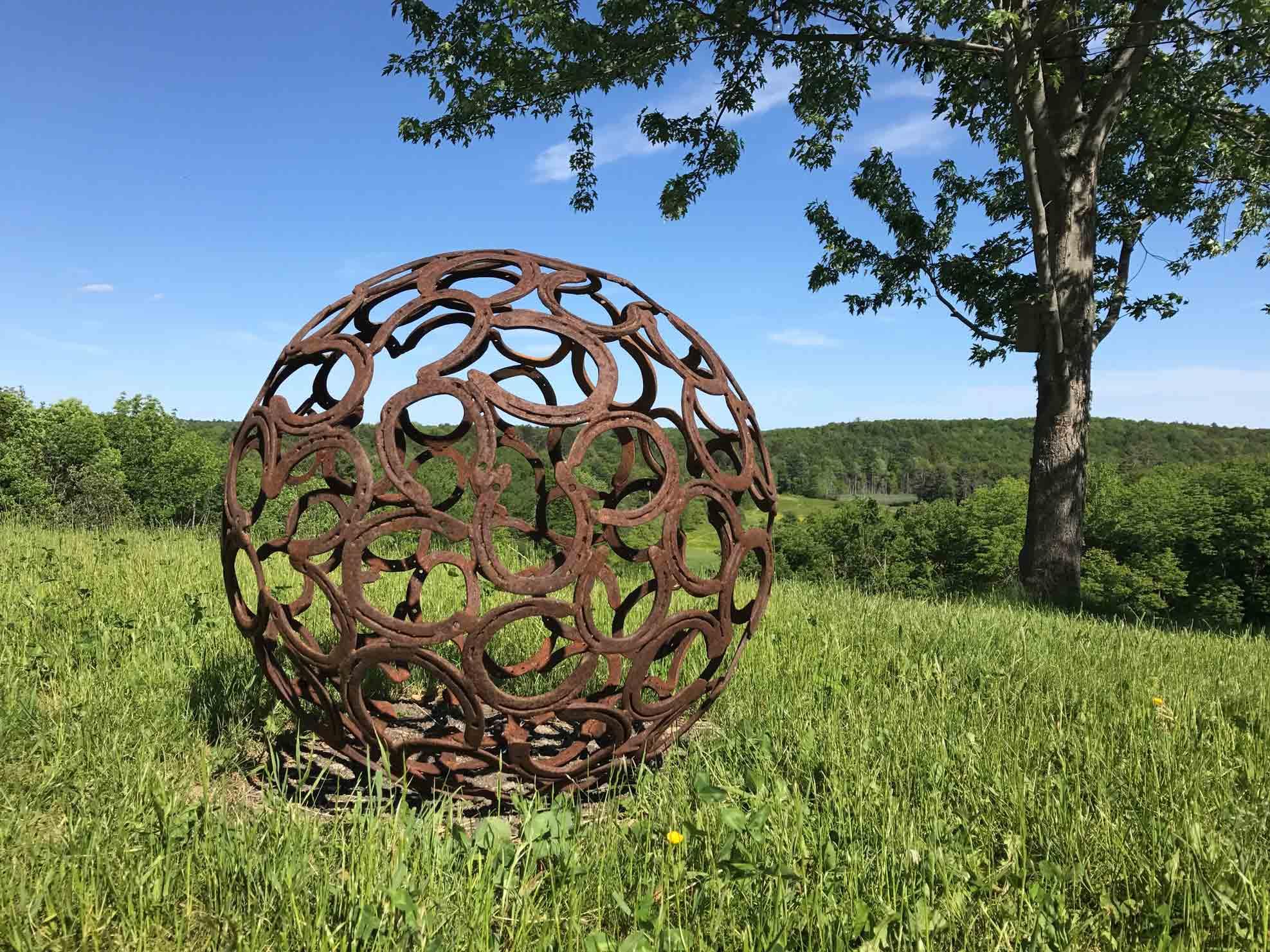 """Feeling Lucky"", 32″ Horseshoe Sphere, Steel Number XIV by Jay Sawyer $1,600"