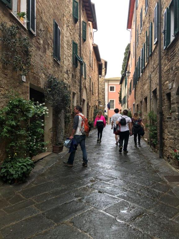 A walk through the narrow winding streets of San Quirico d'Orcia.