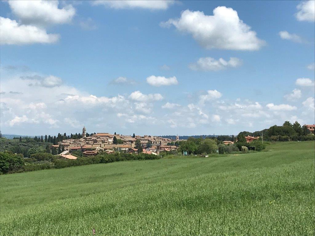 San Quirico d'Orcia, as viewed from one of the many hiking paths leading out from the town to the neighboring villages.