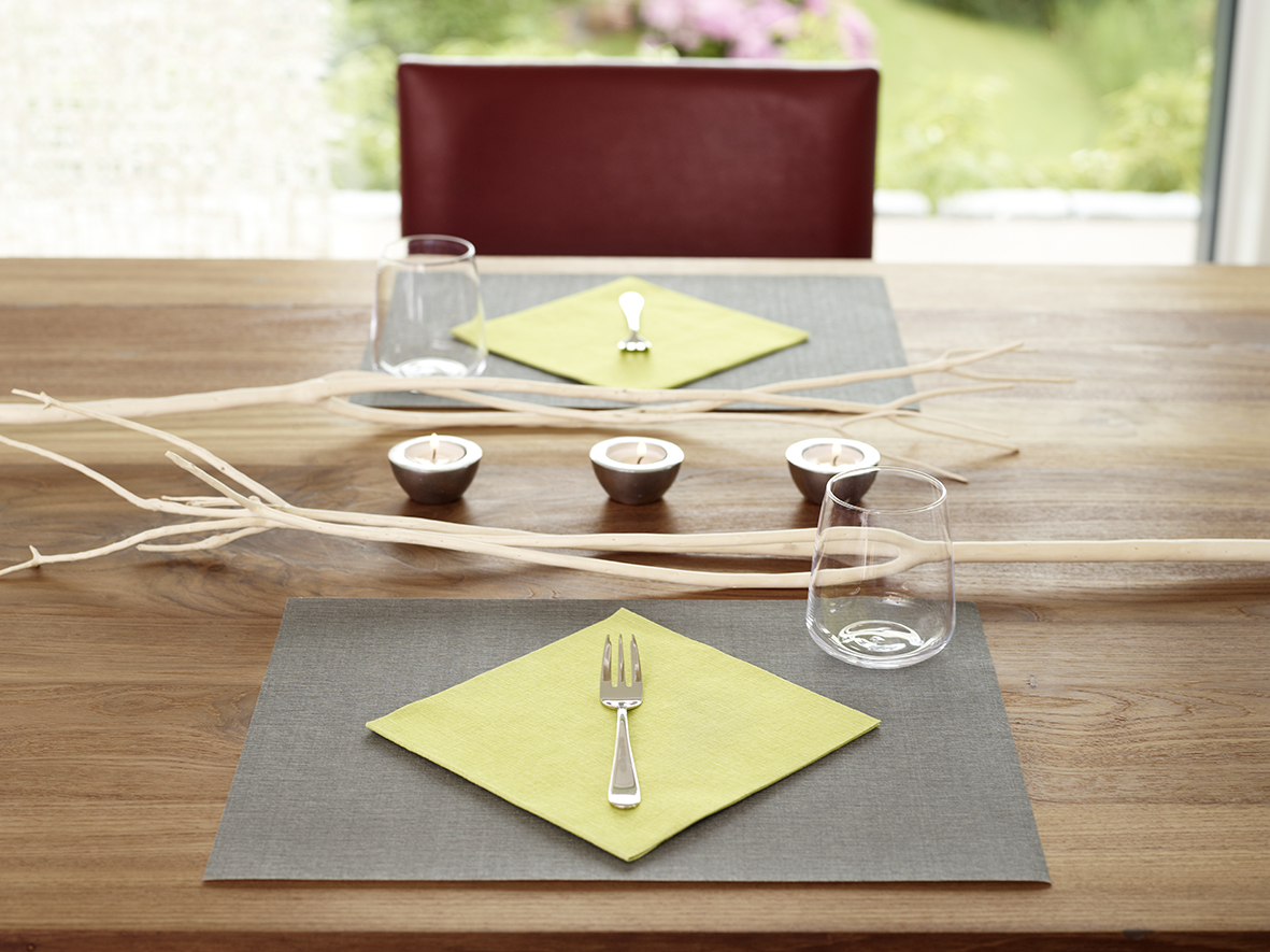 Lifestyle_placemat with napkin_dark grey and kiwi.jpg