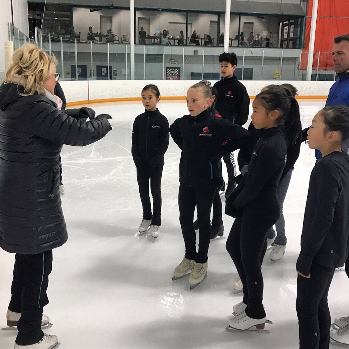 Joanne with Scott Davis working with BC Team skaters at the BC Team Development camp