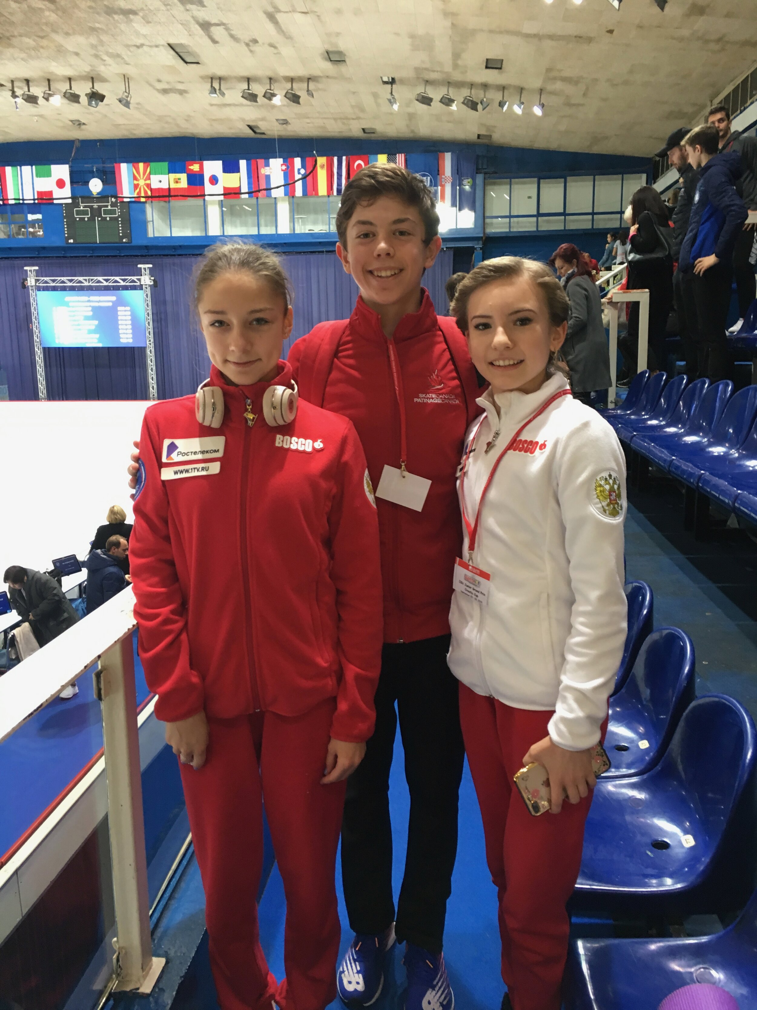Aleksa after the long program with Russian skaters Daria Usacheva & Anna Frolova