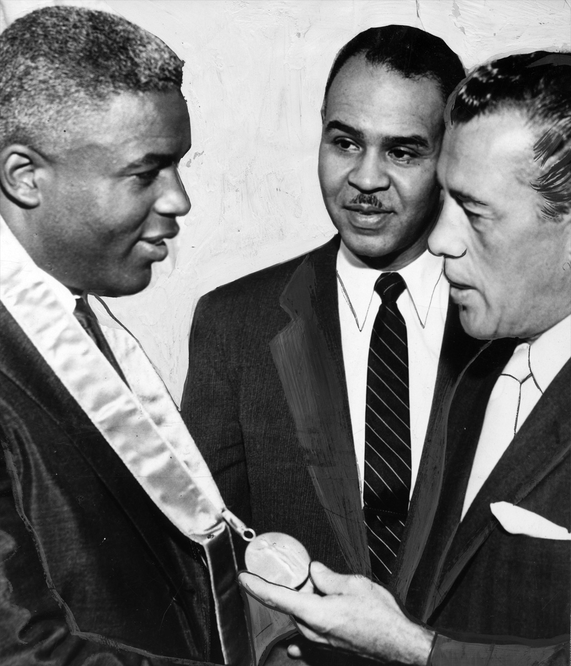 Jackie Robinson receives the NAACP Spingarn Medal from Roy Wilkins (center) and Thurgood Marshall (right), 1956. The medal will be among the artifacts on display in the museum.  Getty Images