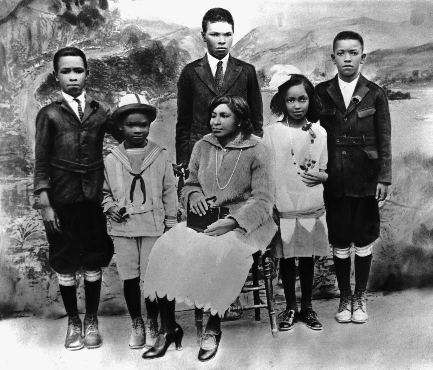 Family portrait of Mallie Robinson (seated) with her children, from left, Mack Robinson, Jackie Robinson, Edgar Robinson, Willa Mae Robinson and Frank Robinson, circa 1925.  Getty Images/Hulton Archive/Staff