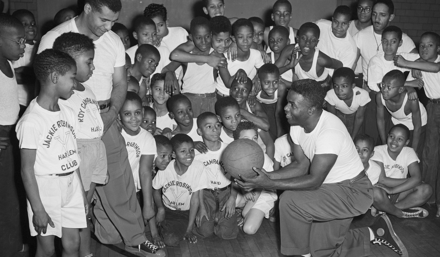 Jackie Robinson and Roy Campanella of the Brooklyn Dodgers at a YMCA Harlem basketball camp, circa 1940s.  Getty Images/Bettmann /Contributor