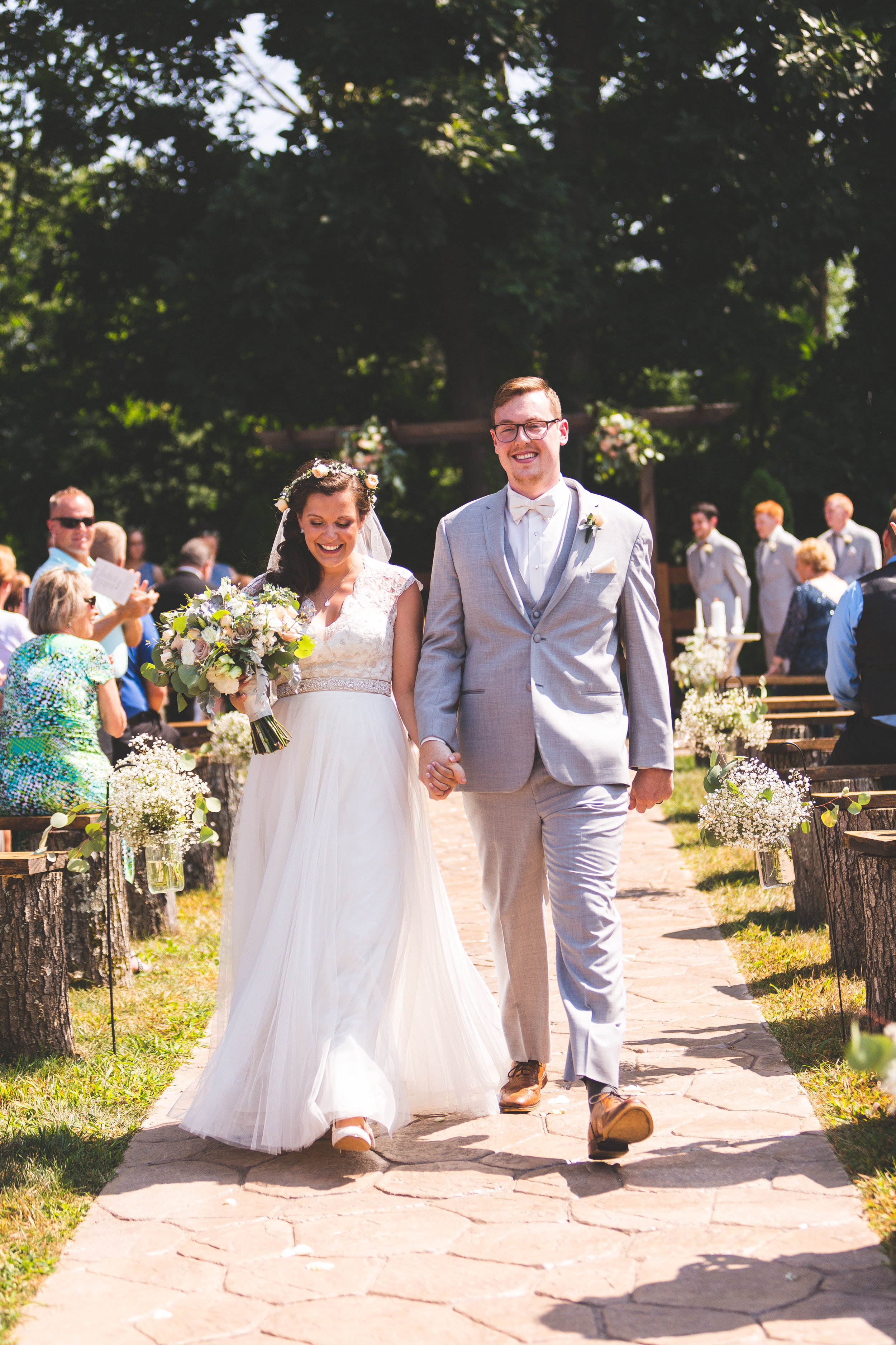 Wedding & Engagement Photography - Our wedding packages include a hand made, professional bound album of your day, and print rights. Our best packages include videography. Photography starting at $1,200.