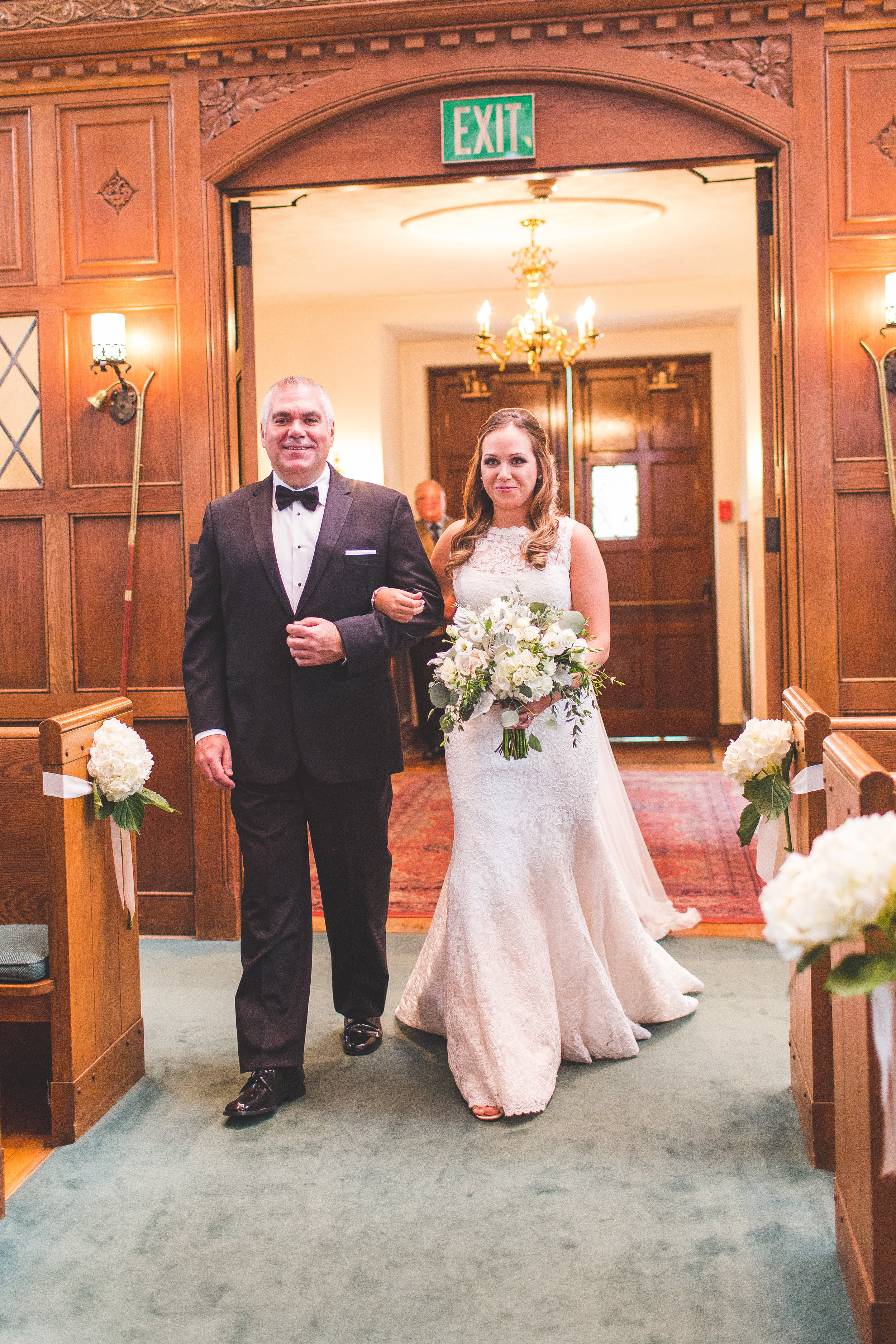 Father and bride isle walk traditional church