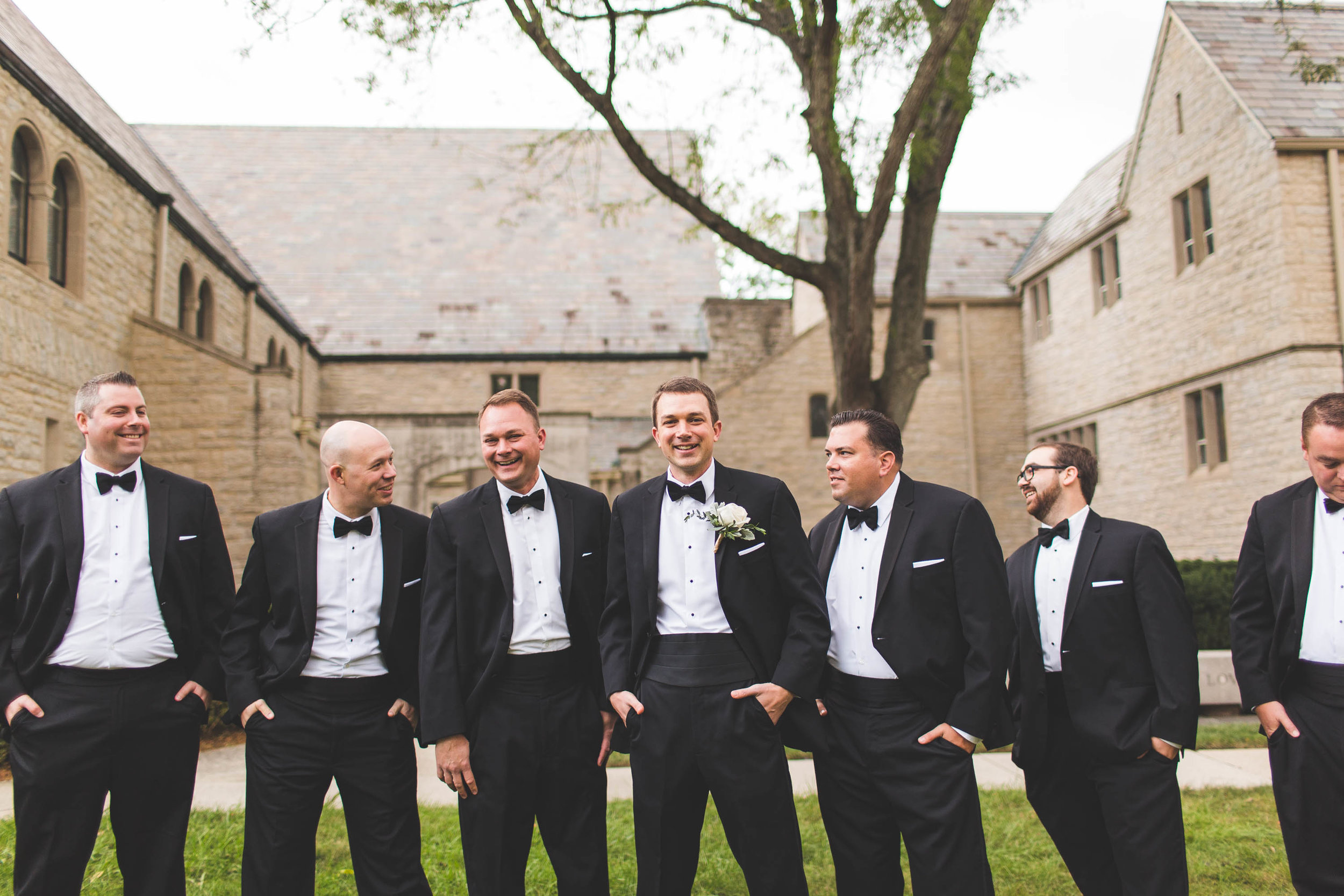 groomsmen laughing at Columbus Ohio wedding first community church