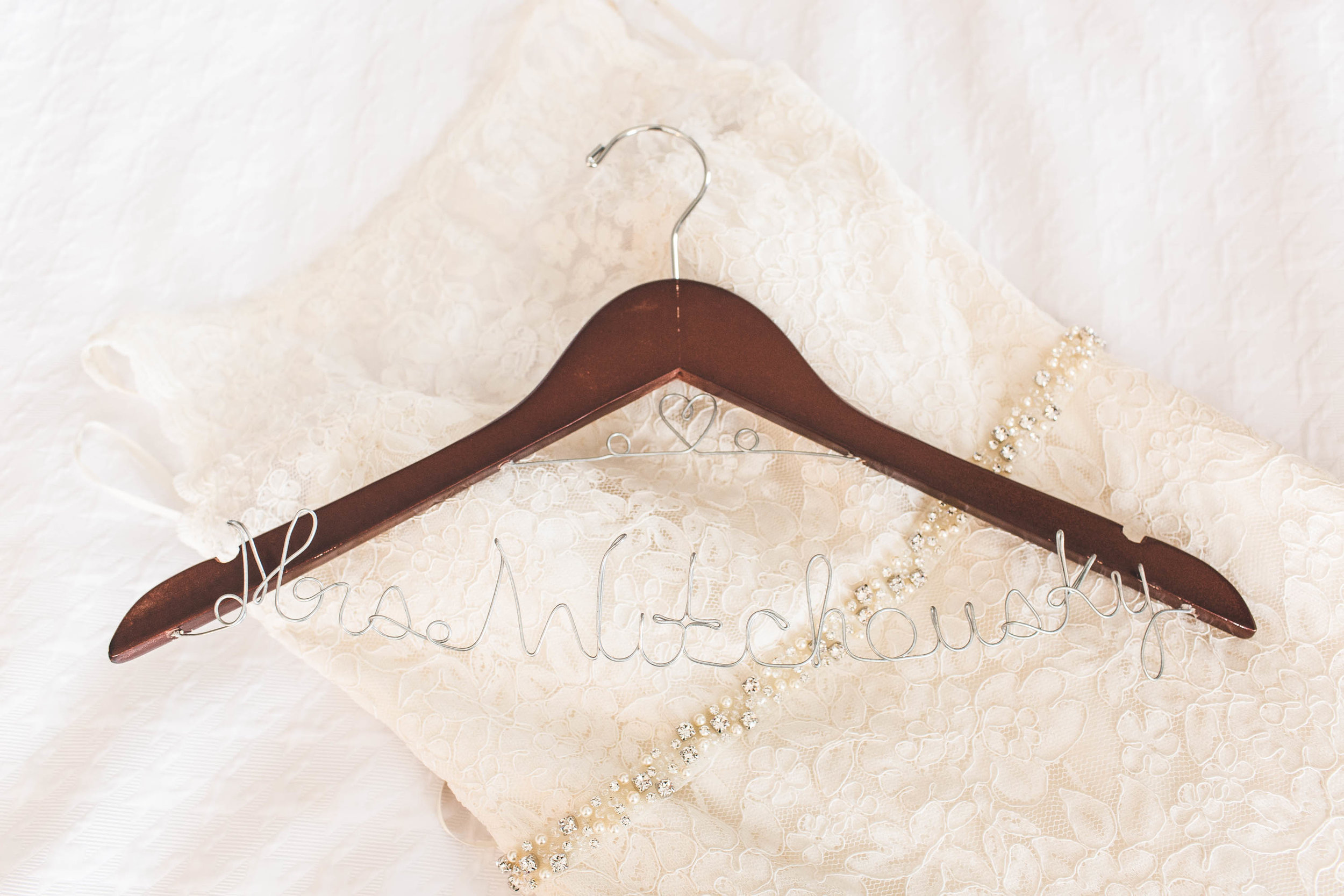wedding dress and hanger with last name