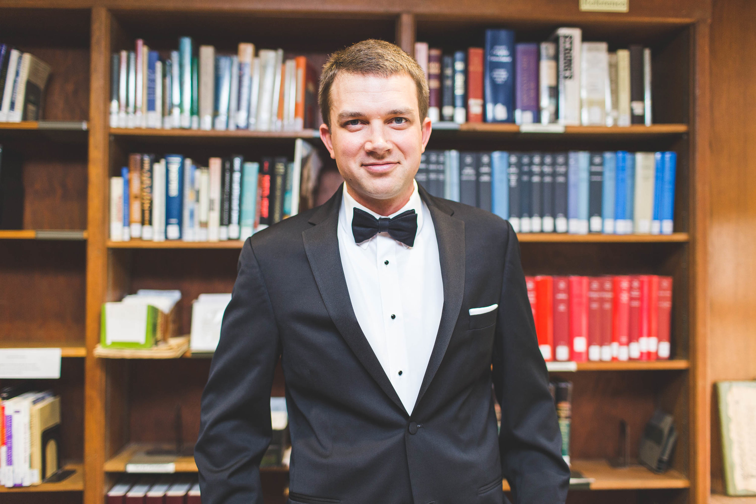 groom in church library on wedding day