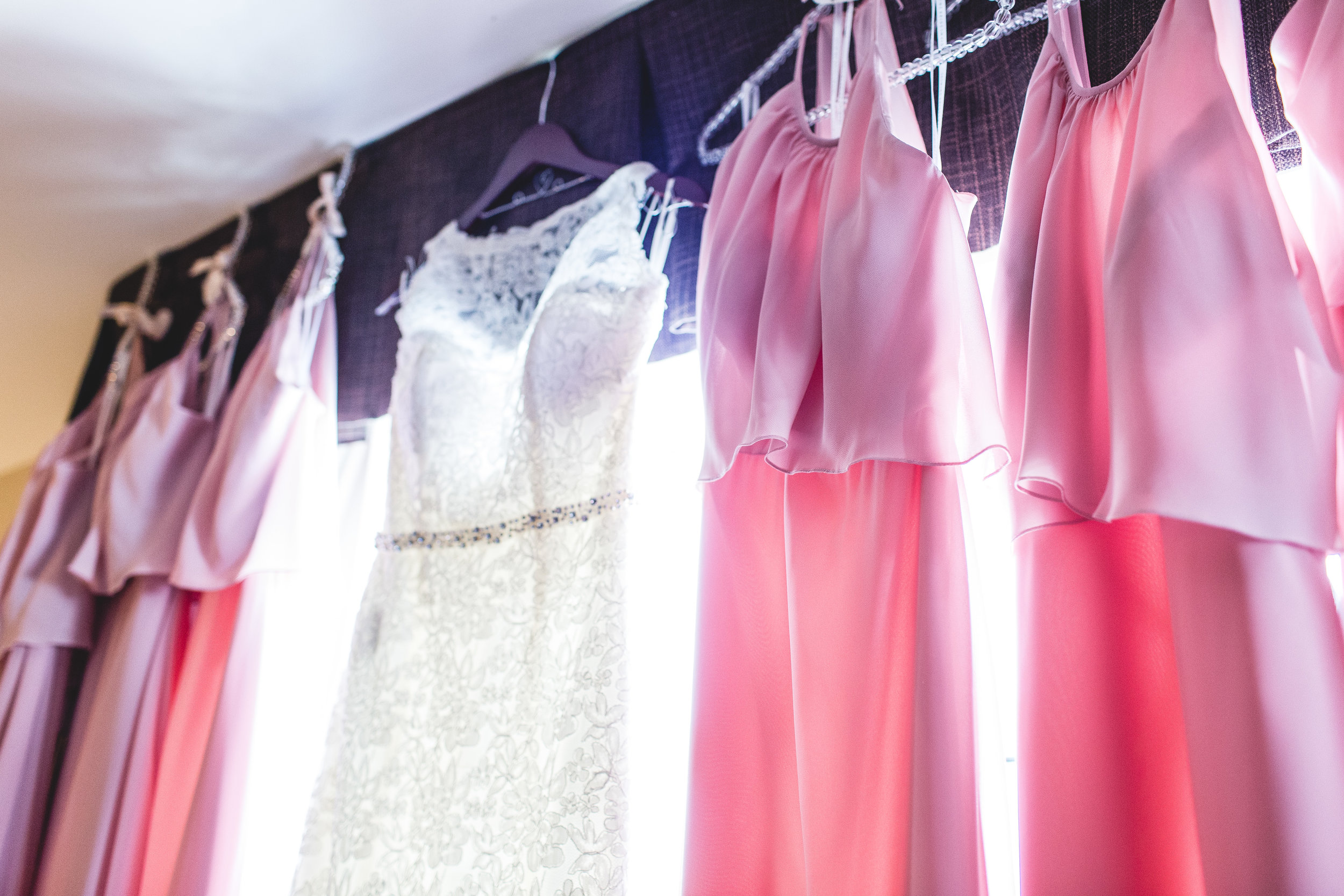 lacy bridal party dresses hanging in a window in columbus ohio