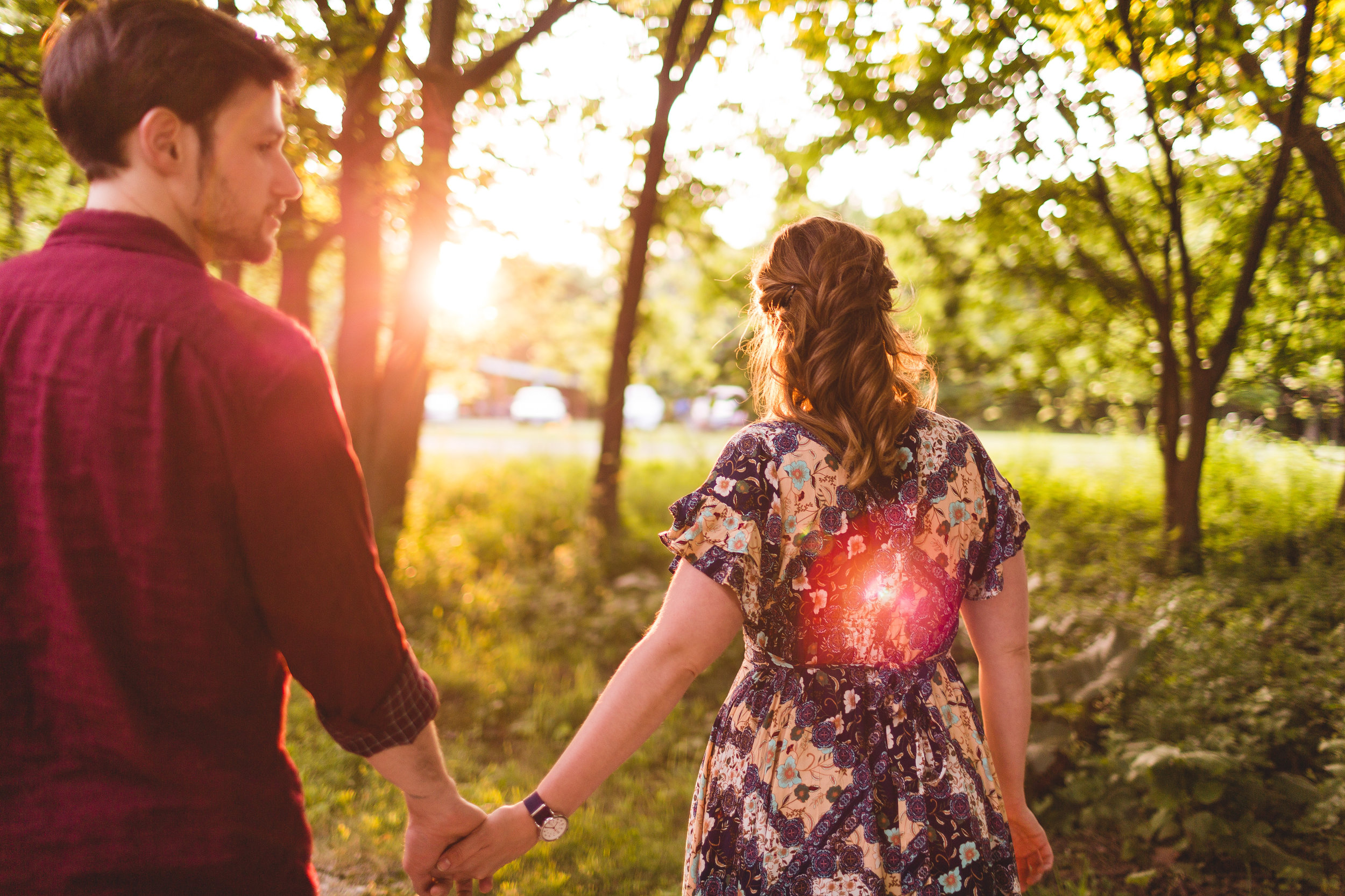 woman walks fiancé through woods during sunset in Pickerington Ponds Park in Ohio