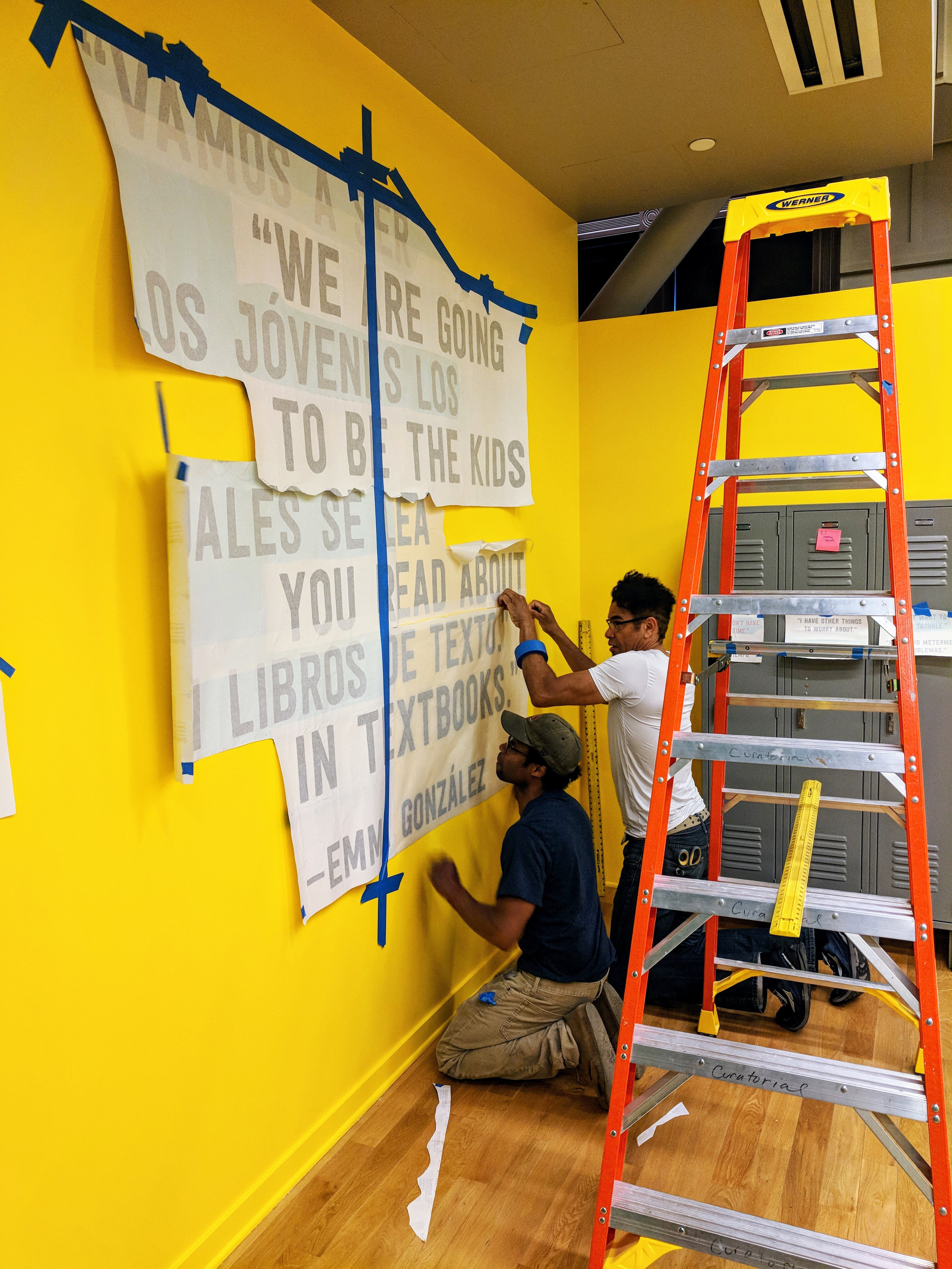 Installing supergraphics in the gallery.