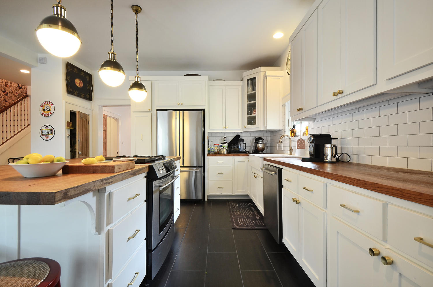 kitchen remodel with white shaker cabinets, gold pulls