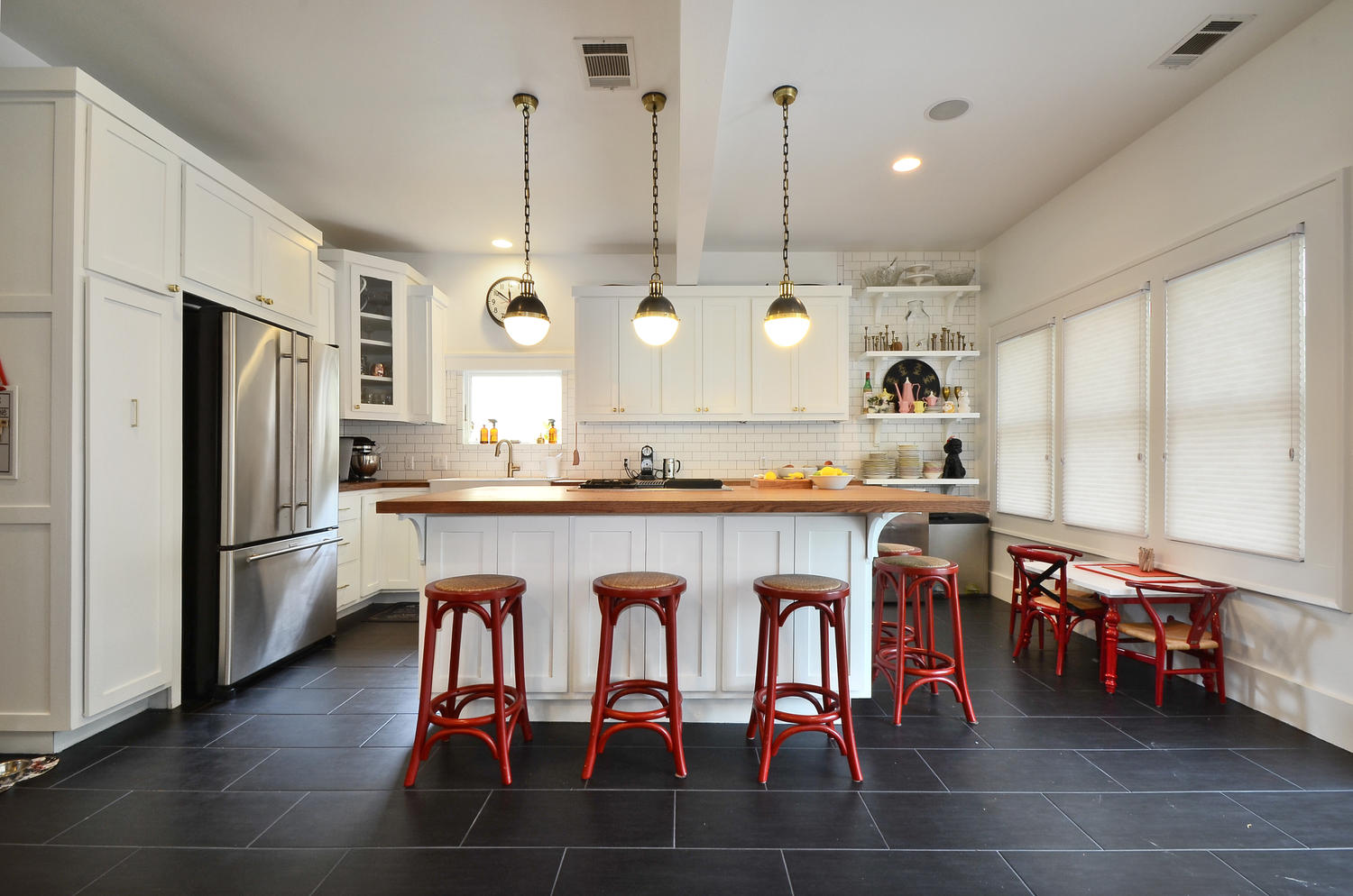 modern farmhouse kitchen with red barstools