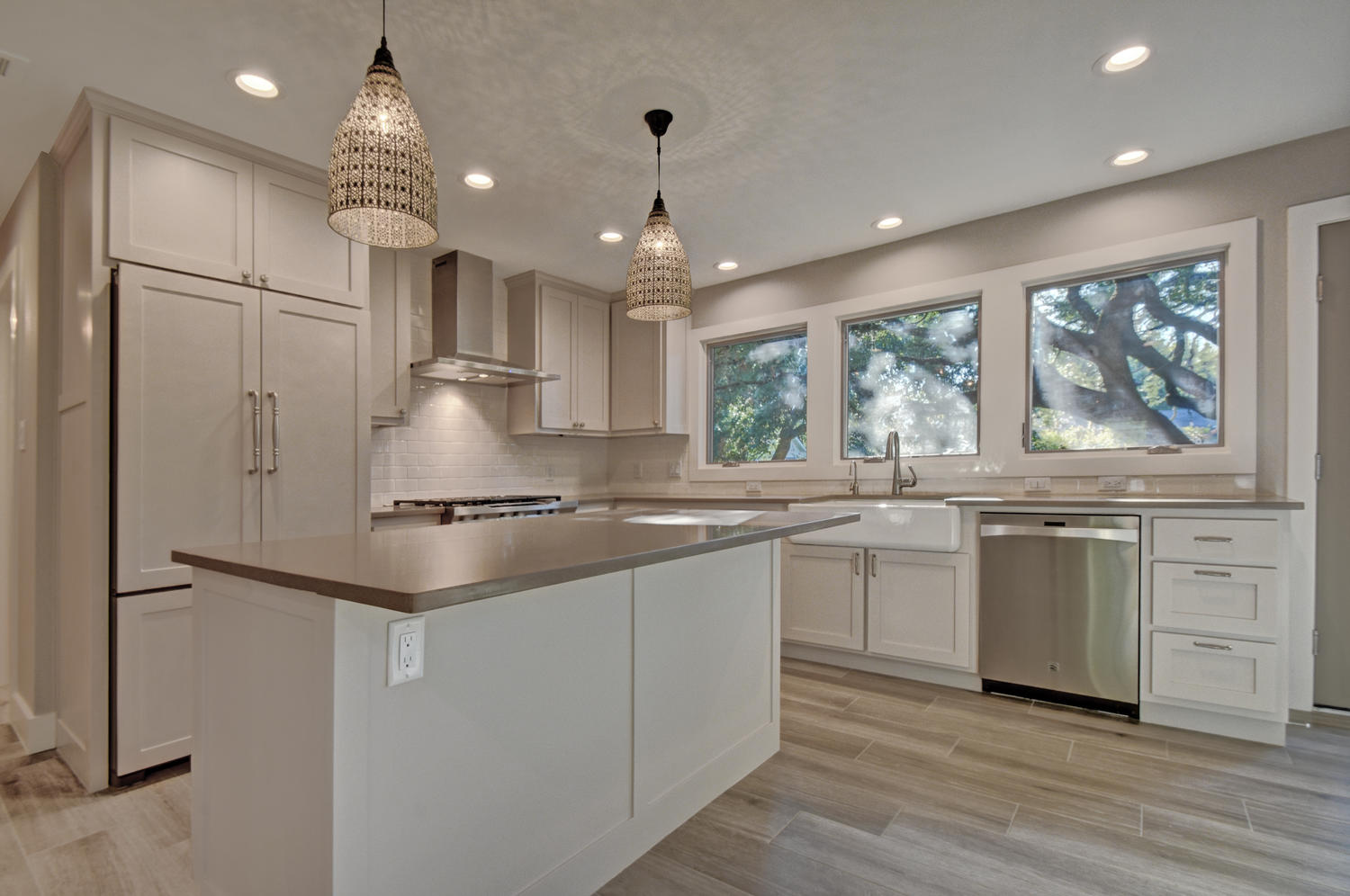 kitchen with windows above cabinets