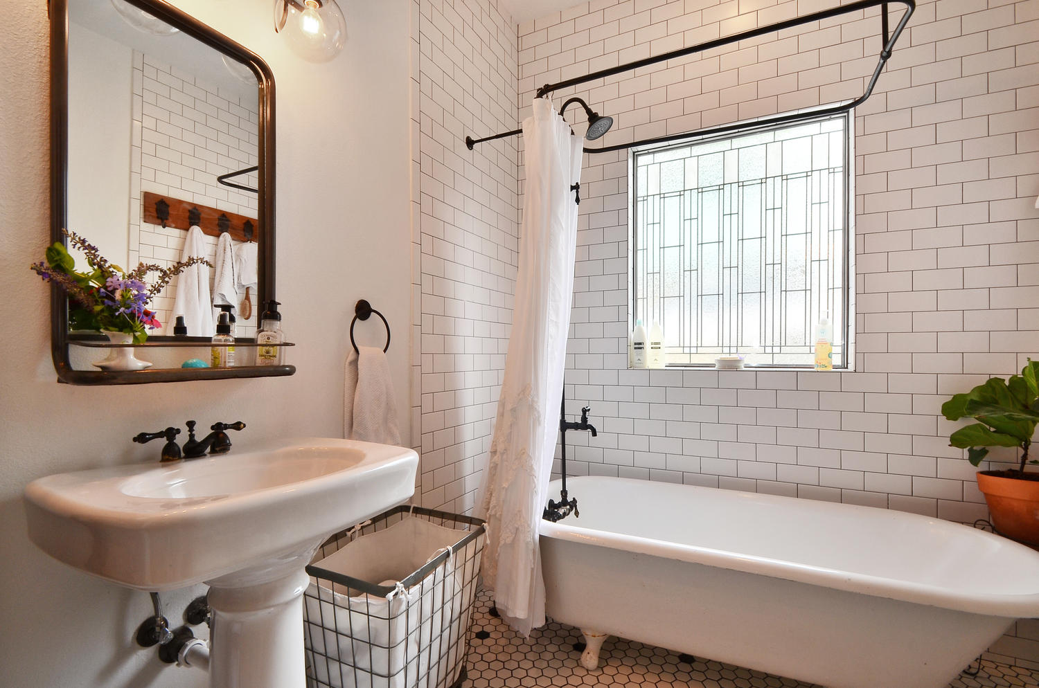 Bathroom Remodel in Austin with pedestal sink and clawfoot tub