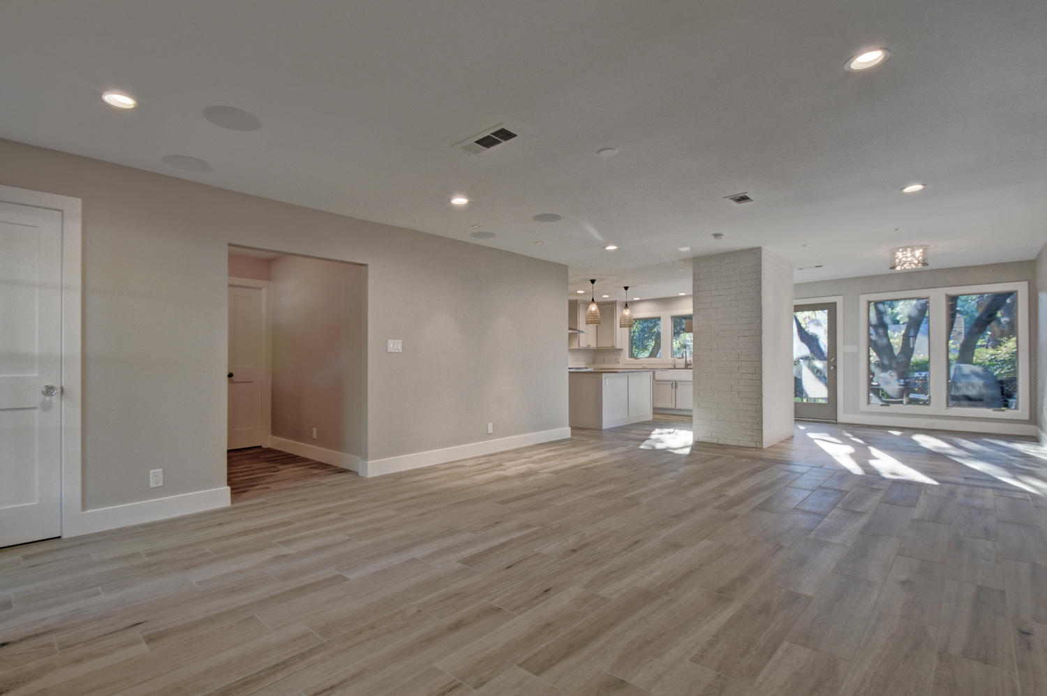 large open family room with ceramic wood-look tile