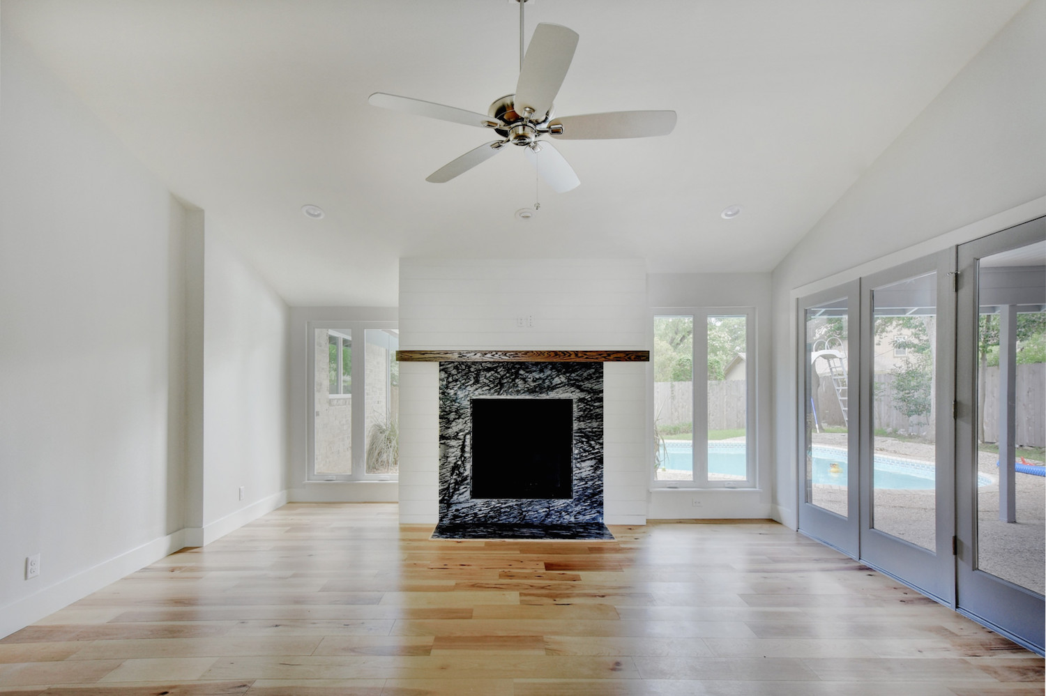 large open room with fireplace focal point