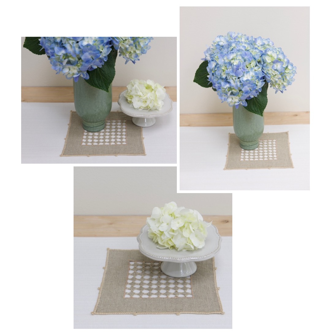 White Hydrangea on White pedestal from magnolia hearth and hand product line at Target. Blue Hydrangea in Tall Vase on Target Table Runner.
