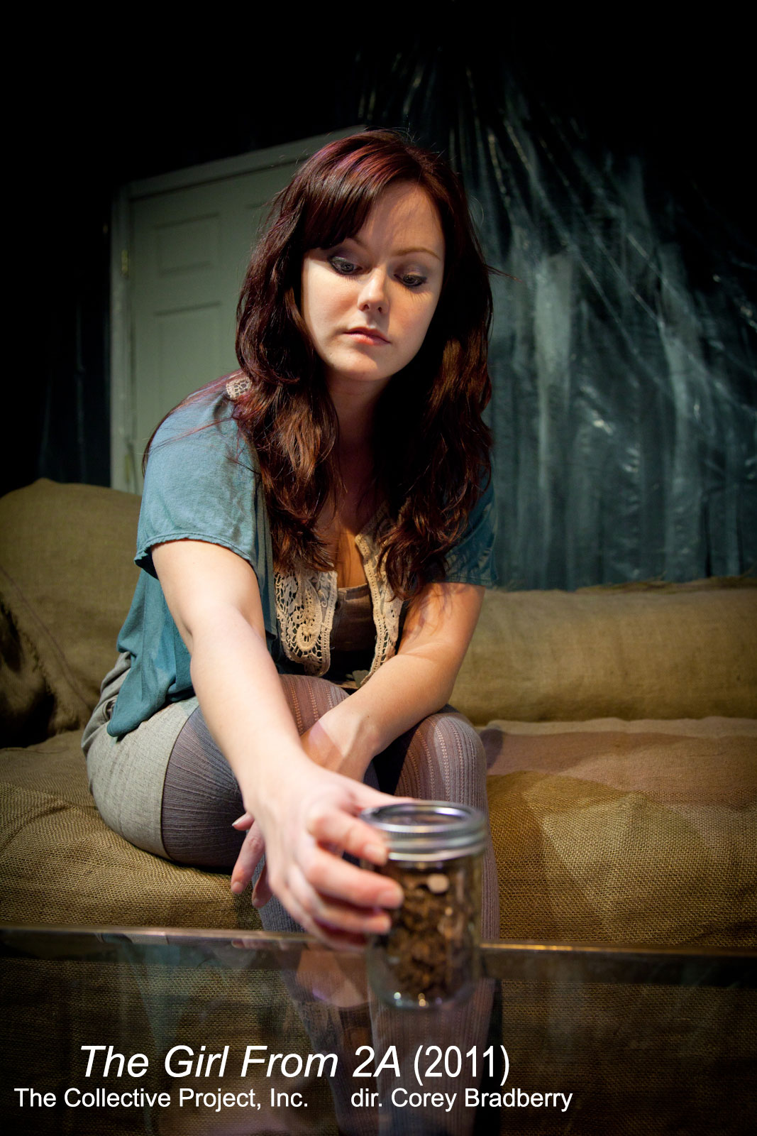 Charlotte Brown (Tracy Vaden Moore) examining a jar's contents in  The Girl From 2A  (2011).