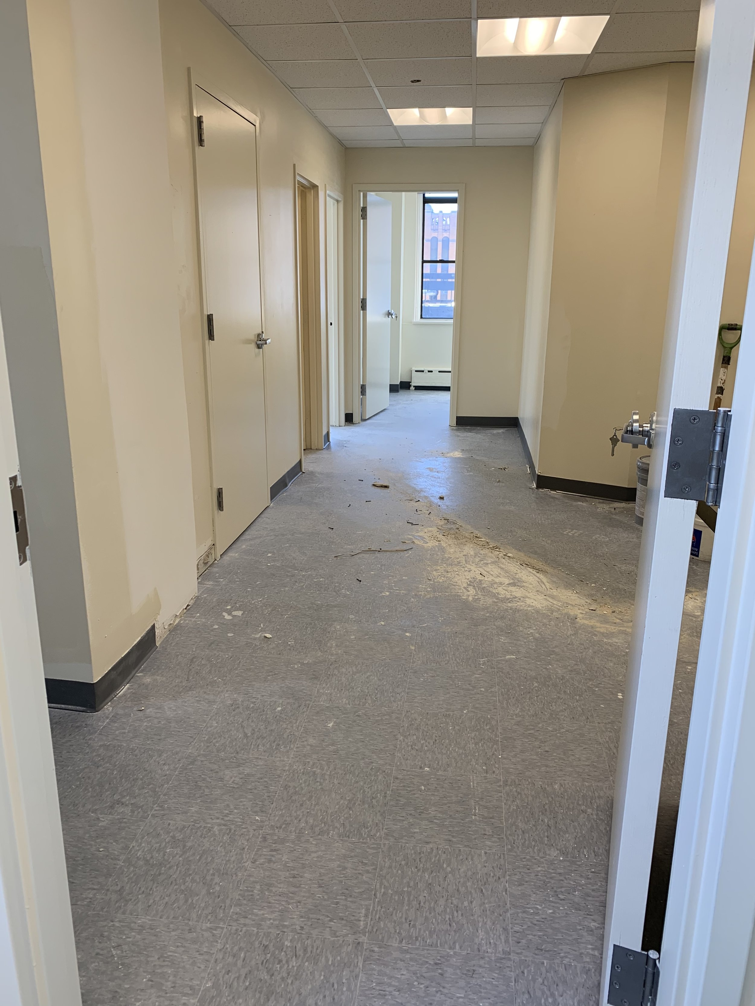 The main hall of our manufacturing suite, complete with offices, kitchen, and multple workspaces.