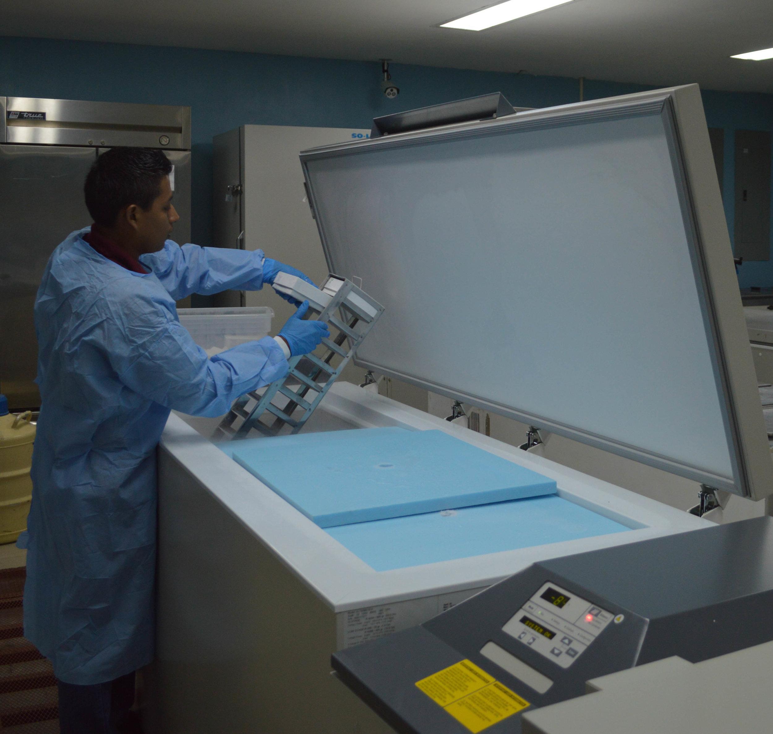 Lab scientist at big machine.jpg