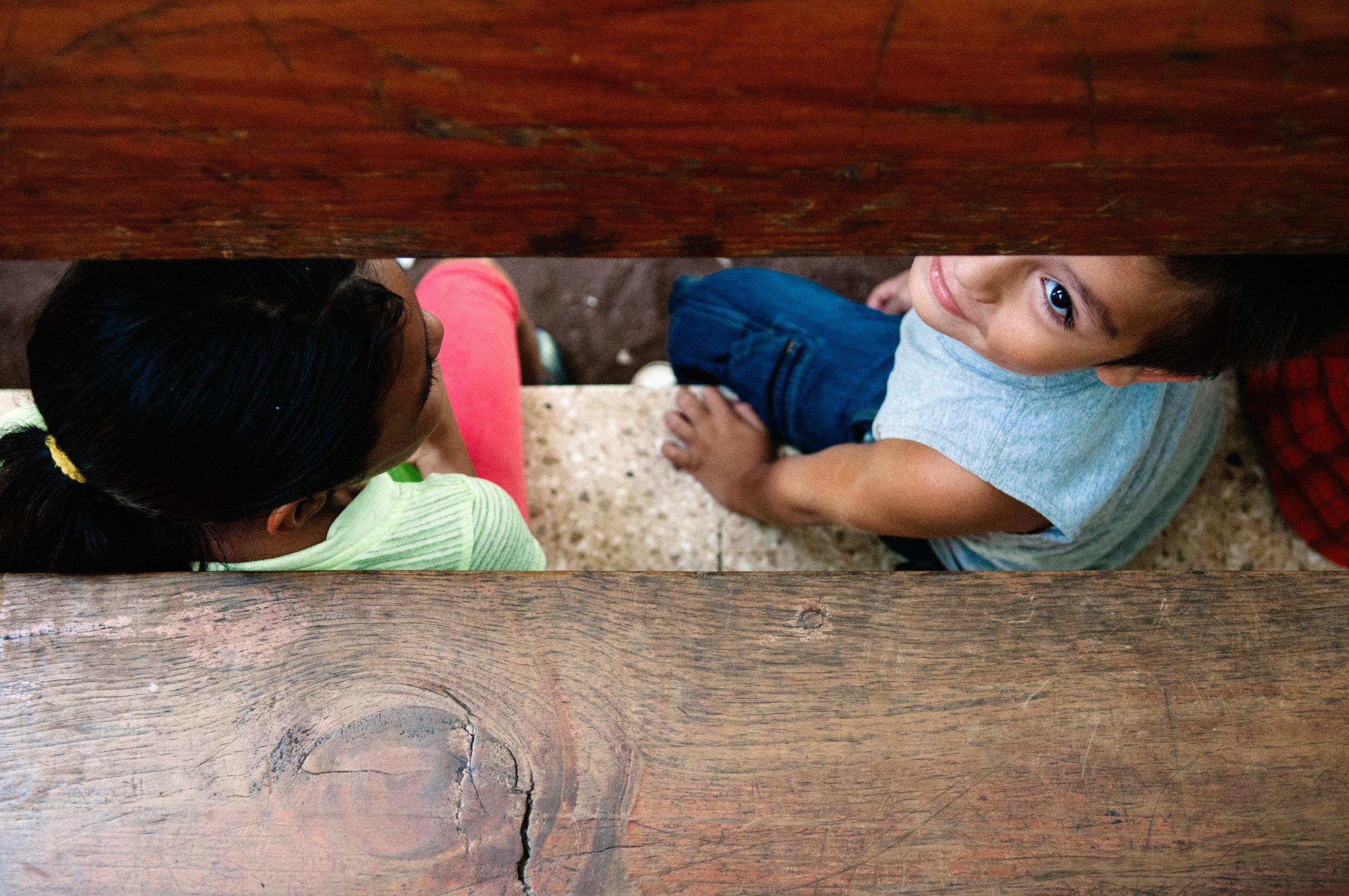 Kids looking through bench.jpg