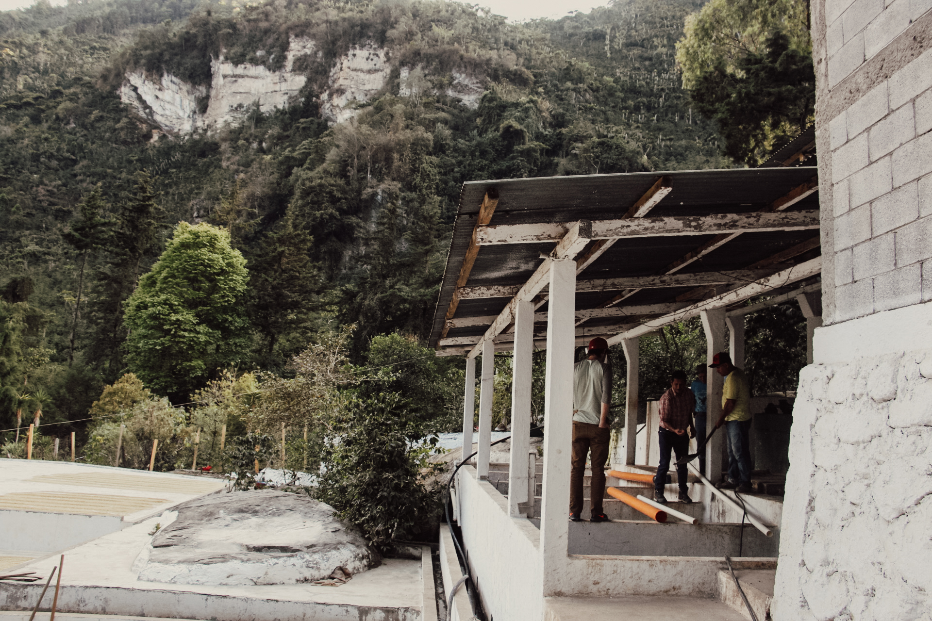 Chalk white cliffs overlook the wet mill and patios at Jenner, Rodin, and Dennis' new finca.