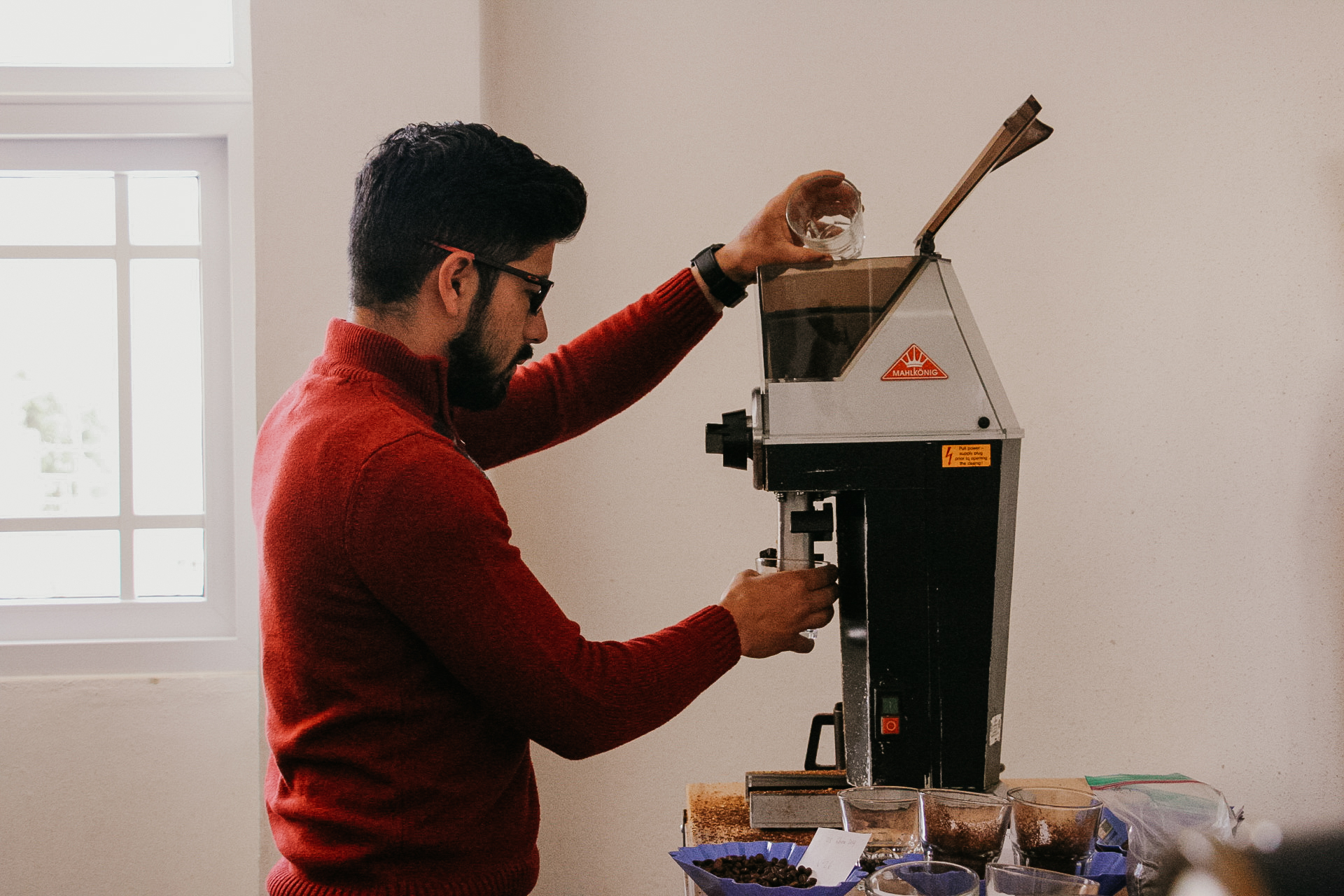 Rodin grinding coffee for our cupping