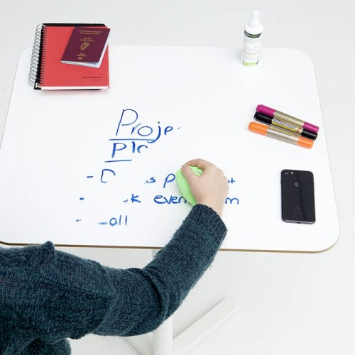 Smart-Self-Adhesive-Whiteboard-Film-creates-writable-desk-which-is-being-erased-using-cloth.jpg