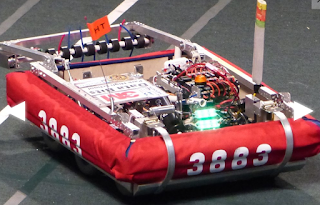 "2016 - Phoenix Bot - This was our robot for the 2016 season. This robot was named this because it had performed not as we had hoped our first game. However, in our second competition it seemed to have risen from the ashes and we did very well. When building our robot we knew that there were too many elements of the game for our team to focus on all of them. We decided that having a strong and accurate high goal catapult was important to our team and we had the ability to cross over 5 of the 9 defenses.This robot was made for the 2016 game, ""FIRST Stronghold"". The start of the game has you build defenses, once one enemy robot crosses it, it is considered damaged. After another crosses it, it is considered broken. The goal is to cross the field and launch boulders in the other teams stronghold while defending yours. In the last 20 seconds the robots were instructed to surround and climb a tower to earn extra points in the end game.Game Animation"