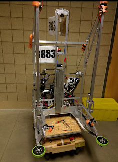 "2015 - B.E.N. Bot - This was our 2015 robot. B.E.N. stands for Be Educated Now. We worked towards having an efficient intake so we could pull in a tote, lift it up, and pull another tote in underneath. We could consistently stack 3 totes, but were unable to place a recycle bin on without the tower falling over. We also had a fun time with the human player task which was throwing pool noodles from our alliance side to the other.This robot was designed for the 2015 game, ""Recycle Rush"". In this game you stacked boxes for points on certain platforms. The more boxes you stacked, the more points you earned.Game Animation"