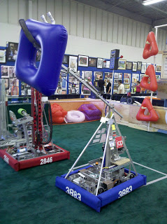 "2011 - K.I.S.S. Bot - This was our first robot, built in 2011. Named KISS for Keep It Super Simple, something one of our mentors would often say. We had the ability to place the blown up shapes on any of the lengths, but we mostly placed them on the second level.This robot was built for the game, ""Logo Motion"". The aim of the game was to hang shapes on their grids. The game ends with a mini bot race, whichever gets to the top of a pole first wins bonus points.Game Animation"