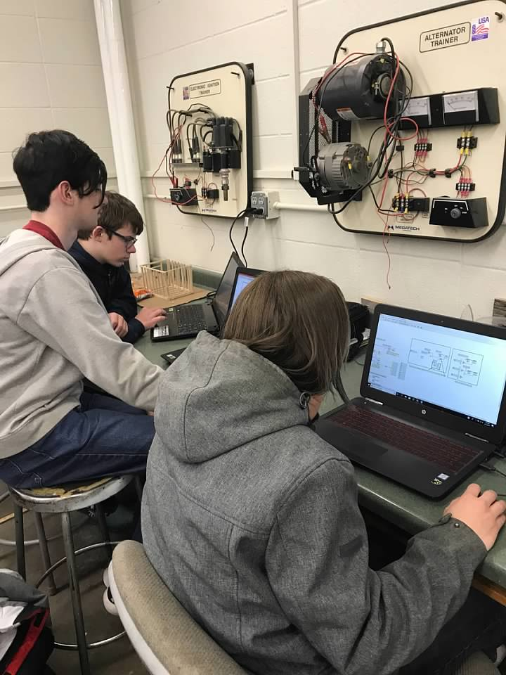 Programming students John, Ethan, and Jacob hard at work in Labview!