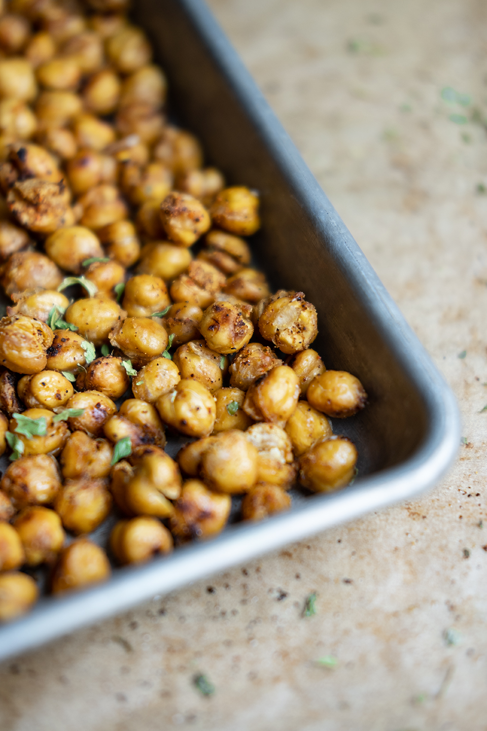 Spicy roasted chickpeas on a metal tray.