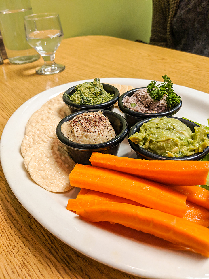 Portia's Cafe side sampler with rice crackers and carrots.  No-Tuna, Spinach and Artichoke dip, hummus and guacamole.