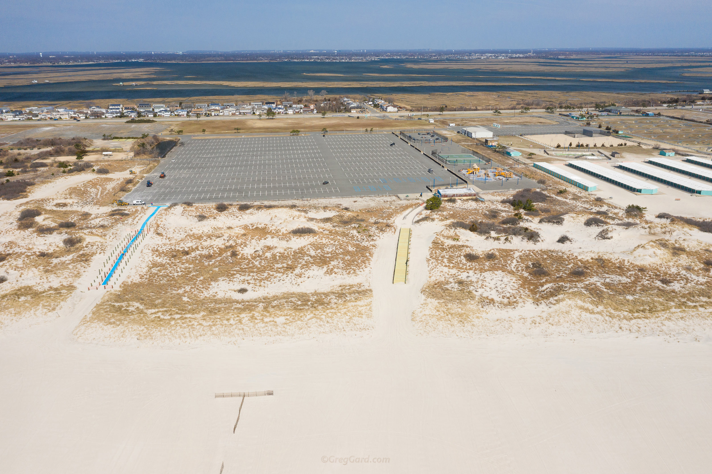 Beach entrances as seen from above - main parking lot at the far distance, bathrooms on the right - Note for the first comers, this is the direction you would be walking back to the parking lot from the beach - Area A on the right
