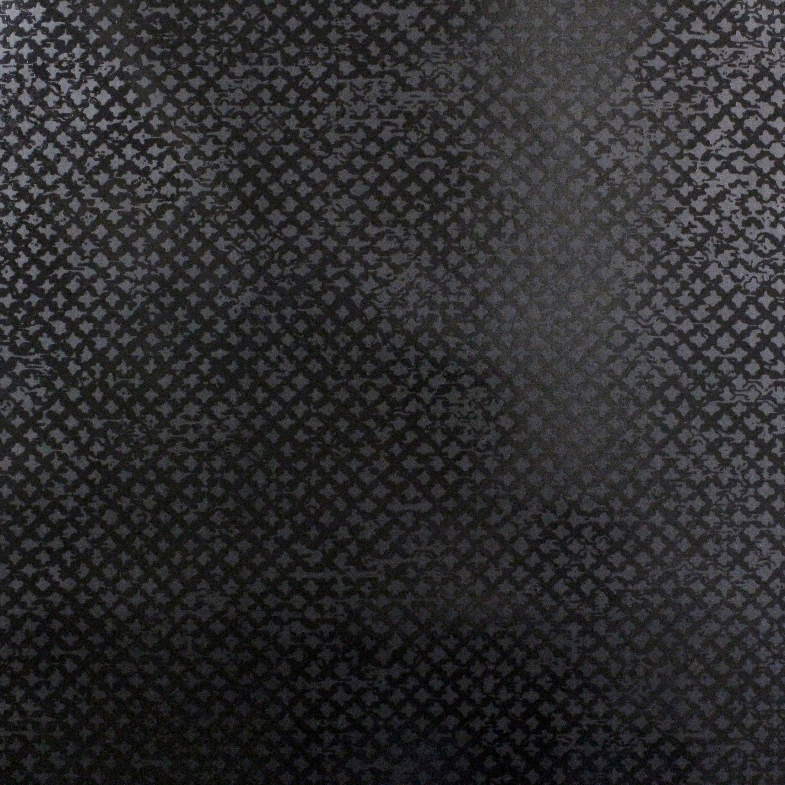 Above: subtle texture achieved by printing gloss black ink onto matt black paper (Design: Treillage from the Chic wallpaper collection - SPW-TR05)