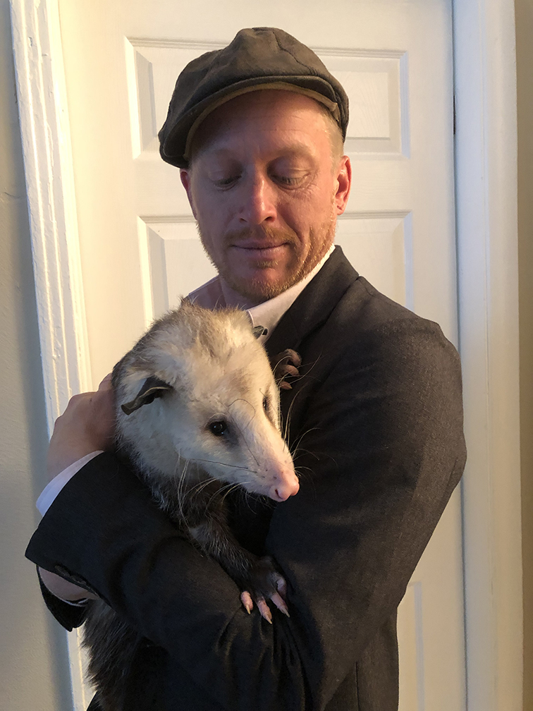 My boyfriend Mason holding an Opossum.
