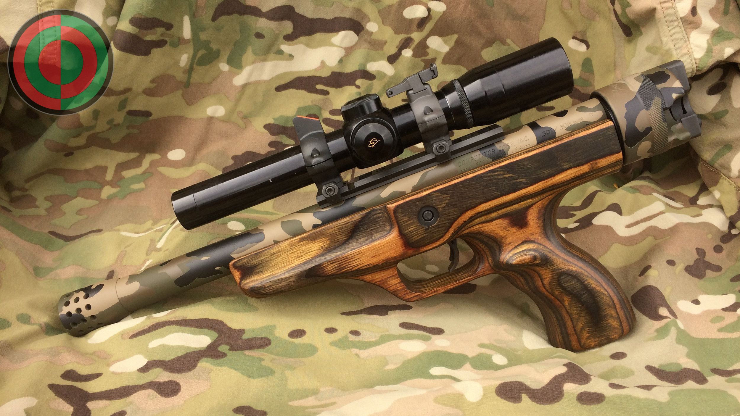 Competitor .308 - A four color camo pattern made with Cerakote. Parkerized base and rings.