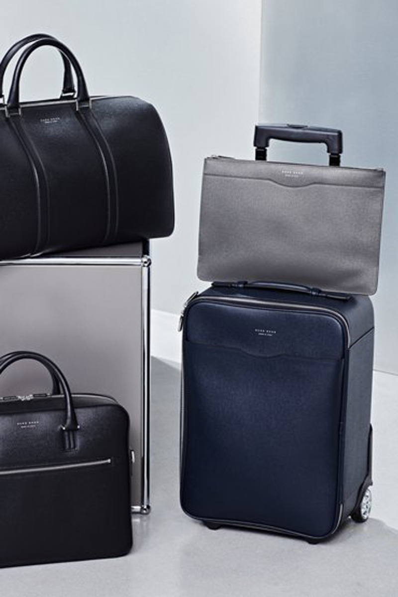 BAGS A gym bag won't cut it for business travel. Upgrade your carry-on with BOSS, and discover our range of trolley bags, laptop cases and holdalls, crafted from grained Italian leather.
