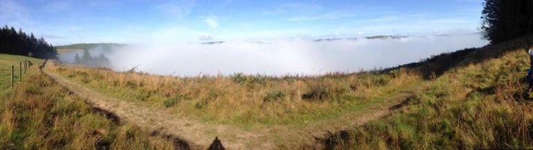 View-above-the-campsite-with-mist-768x216.jpg