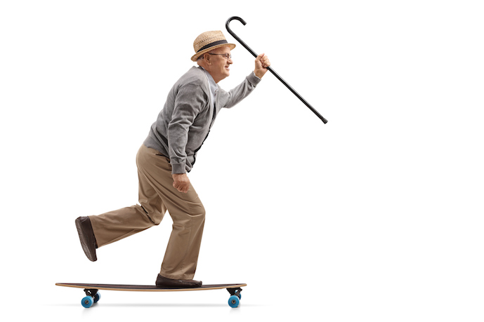 Older man staying steady on his feet with walking stick